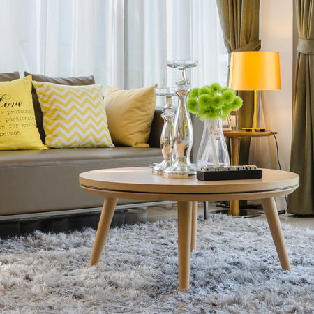 wooden round table on carpet in modern living room
