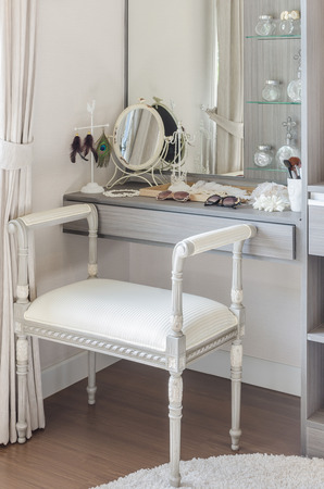 dressing table: classic white chair with dressing table at home