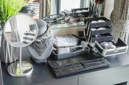 dressing table: black dressing table with accessories at home