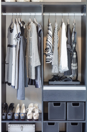 black and white clothes in black closet at home