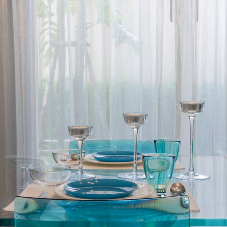 dinning table: modern glass dinning table with table set at home