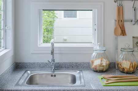 stainless steel range: stainless steel sink in modern kitchen at home