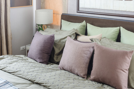 king size bed: pillows on king size bed with modern white lamp at home