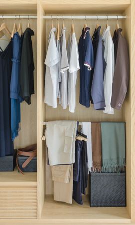 white clothing: wooden closet with clothes hanging at home