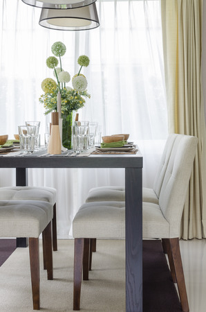 dinning table: table set on wooden dinning table at home Stock Photo