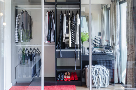 walk in closet: walk in closet with glass partition in bedroom at home Stock Photo