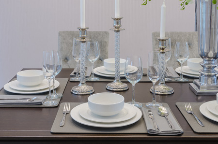 dinning room: table set on wooden table in luxury dinning room at home Stock Photo