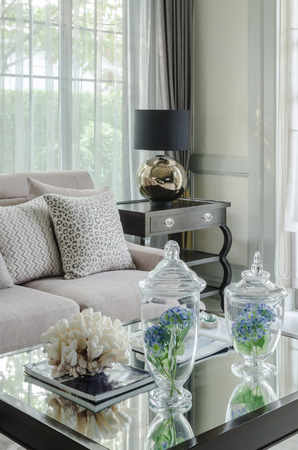 glass vase of flower on glass table in luxury living room at home
