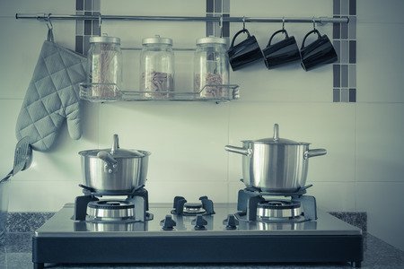 stainless steel range: utensil in kitchen room - vintage style effect picture