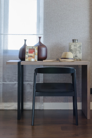 home corner: black chair with wooden table in working corner at home Stock Photo