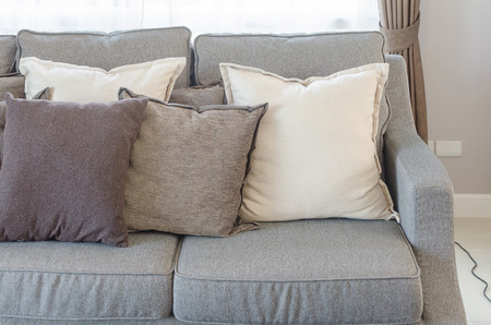 modern living room: modern grey sofa with pillows in living room