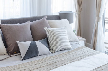 modern bedroom with pillows on bed at home