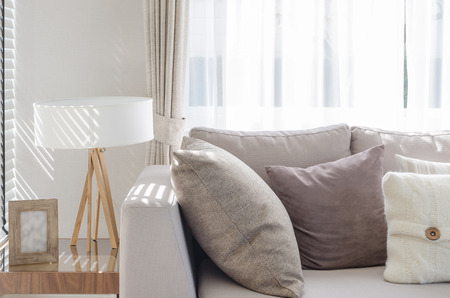 sofa: modern living room with sofa and wooden lamp on table side at home