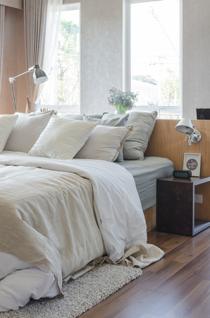 earth tone color pillows in luxury bedroom at home
