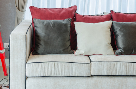 luxury living room: black and red pillows on luxury sofa in living room Stock Photo