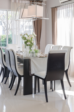 dinning room: modern dinning room with black wooden table and chair at home