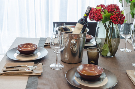 ware house: luxury table set on wooden dinning table with bottom of wine