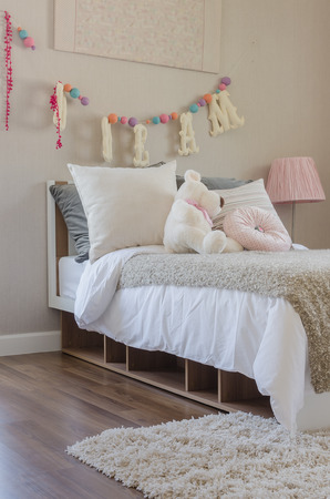 bedroom suite: kids bedroom with pillows and dolls on bed at home Stock Photo