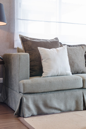 white pillow: classic sofa style in living room with white pillow Stock Photo
