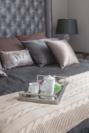 king bed: tray of tea set on blanket in luxury bedroom with king bed size Stock Photo