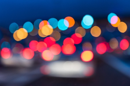 urban transport: abstract traffic jams night light background in rush hour