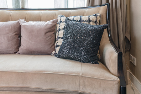 luxury living room: classic sofa style with pillows in luxury living room at home