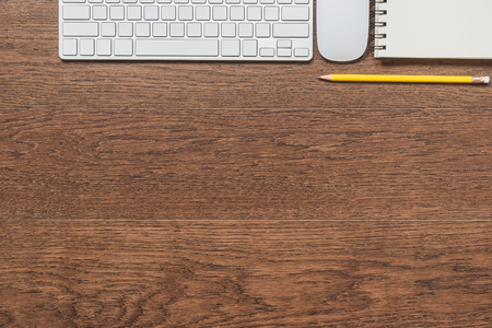 space wood: Office wooden table with notebook, yellow pencil, keyboard, and mouse, top view Stock Photo