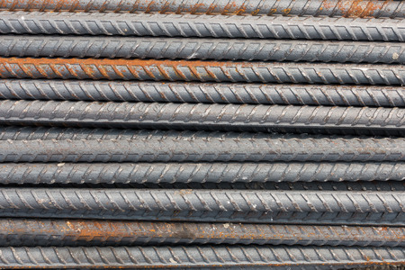 corode: rusty round bar steel used in construction background texture