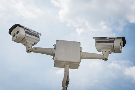 nightvision: two of CCTV security camera with blue sky