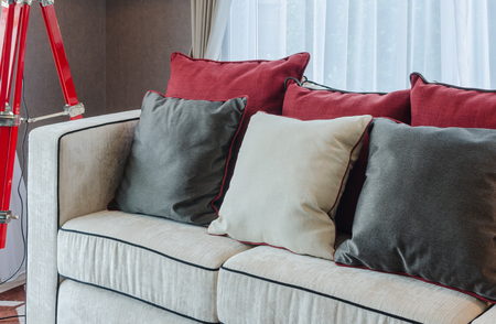 luxury room: black and red pillows on luxury sofa in living room Stock Photo