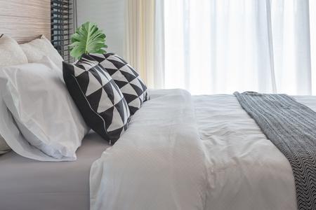bedroom design: black and white pillows on bed in modern bedroom design