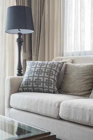 pillow: classic sofa with pillows in living room, interior design Stock Photo