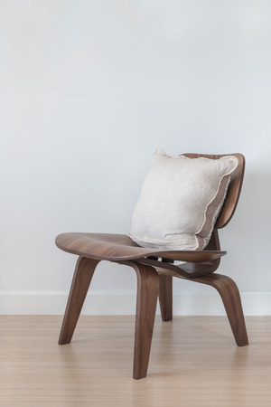 modern chair: wooden modern chair with pillow on wood floor