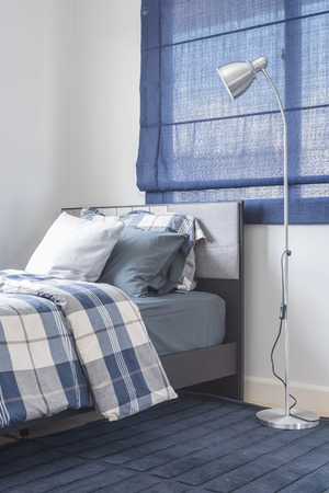 blue carpet: modern bedroom design with modern lamp and single bed on blue carpet