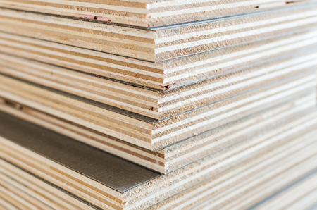 carpenter's bench: layer of plywood in construction site as background image