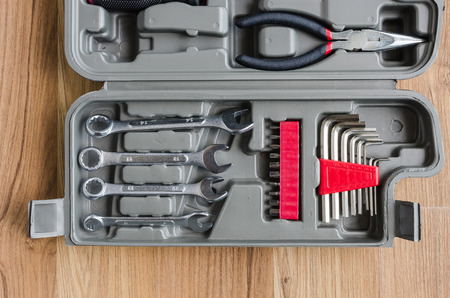 standard steel: box set of metal working tools on wooden background