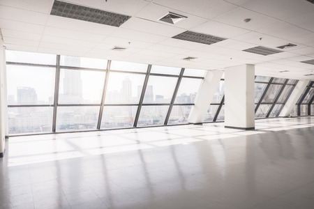 empty office: empty office space with large window, vintage picture style process