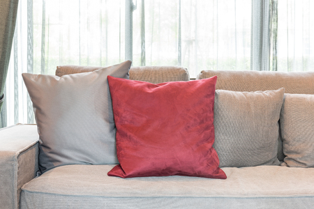 red pillows: red pillows on modern grey sofa in living room