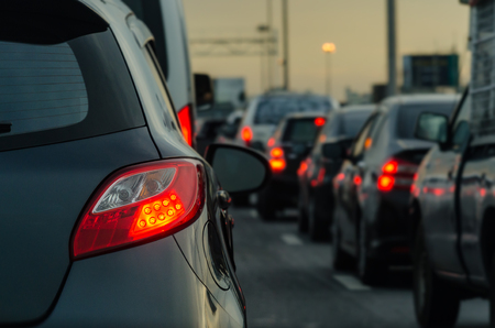drive way: traffic jam with row of cars on expressway during rush hour Stock Photo