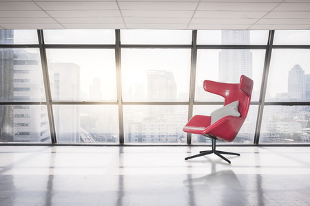 large office: modern red chair in empty office space with large window, vintage picture style process Stock Photo