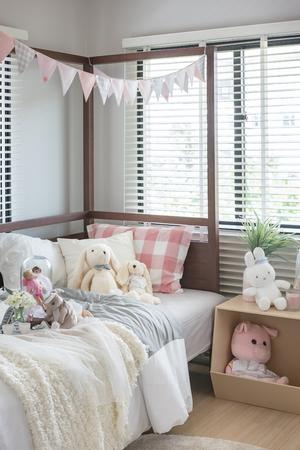 bedroom design: dolls and toy on bed in kids bedroom design