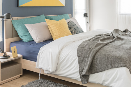 bedroom bed: modern bedroom with colorful pillows on bed