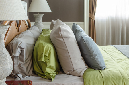 bedroom design: row of pillows on bed in classic bedroom design