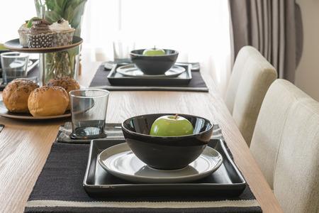 dinning room: table set on wooden dinning table in modern dinning room design