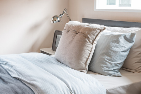 bedroom design: single bed with pillows in modern bedroom design