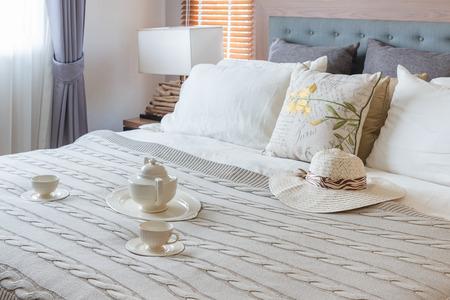 bedroom design: set of tea cup on bed in luxury bedroom design