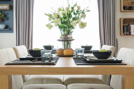house ware: table set on wooden table in dinning room Stock Photo