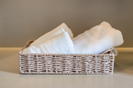 white towels: white towels in basket on wooden wardorbe