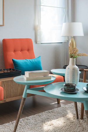 living room design: colorful pillows and round table in modern living room design Stock Photo