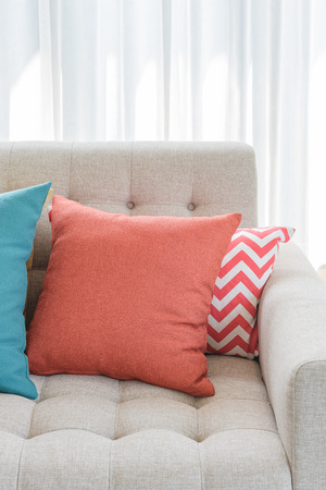 living room design: colorful pillows on classic sofa style in living room design